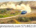 Sports Car on a Bend and a lot of Dust 02 57186219