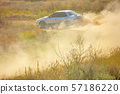 Sports Car on a Bend and a lot of Dust 01 57186220