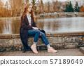 stylish girl near water 57189649