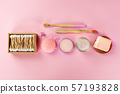 Plastic-free, zero waste cosmetics, flat lay on a pink background. Bamboo toothbrushes and cotton 57193828