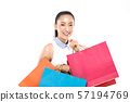 Asian Woman smile and holding shopping bags feeling so happiness and enjoy with black Friday sale in Shopping mall,isolated on white background,Shopping Concept 57194769