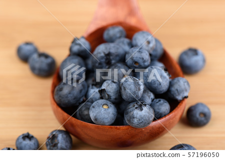 Selective focus. Blueberry berries in a wooden spoon 57196050