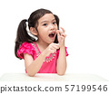 Funny little cute girl 6 years old pulling the milk tooth out on white background. 57199546