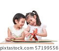 Two little cute girls sitting and reading the picture book on white backdrop. Older sister read the book  to younger sister. Learning and education of kid. 57199556