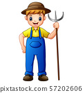 Cute young guy farmer holding pitchfork  57202606