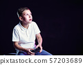 Excited kid playing video game in studio 57203689