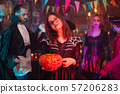 Beautiful young girl smiling to the camera for halloween 57206283