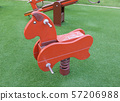 Seesaw in the shape of the horses for the 57206988