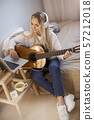 Girl Playing Guitar at Home 57212018