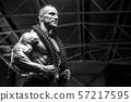 Brutal men muscles workout bodybuilding concept background muscular bodybuilder men exercises in gym 57217595