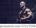 Brutal men muscles workout bodybuilding concept background muscular bodybuilder men exercises in gym 57217596