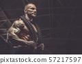 Brutal men muscles workout bodybuilding concept background muscular bodybuilder men exercises in gym 57217597