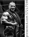 Brutal men muscles workout bodybuilding concept background muscular bodybuilder men exercises in gym 57217598