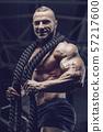 Brutal men muscles workout bodybuilding concept background muscular bodybuilder men exercises in gym 57217600