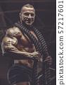 Brutal men muscles workout bodybuilding concept background muscular bodybuilder men exercises in gym 57217601