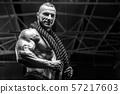 Brutal men muscles workout bodybuilding concept background muscular bodybuilder men exercises in gym 57217603