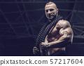 Brutal men muscles workout bodybuilding concept background muscular bodybuilder men exercises in gym 57217604
