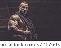 Brutal men muscles workout bodybuilding concept background muscular bodybuilder men exercises in gym 57217605