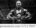 Brutal men muscles workout bodybuilding concept background muscular bodybuilder men exercises in gym 57217607