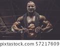 Brutal men muscles workout bodybuilding concept background muscular bodybuilder men exercises in gym 57217609