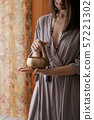 Woman holding in hands singing bowl 57221302
