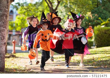 Kids trick or treat. Halloween fun for children. 57221475
