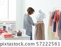 Fashion designer, seamstress and Small-Sized Enterprises concept - woman seamstress decorates a 57222561