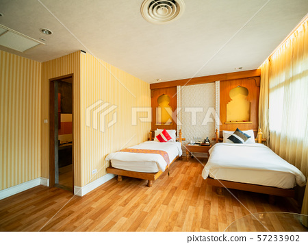 Luxury room with bed in warm light, India style 57233902