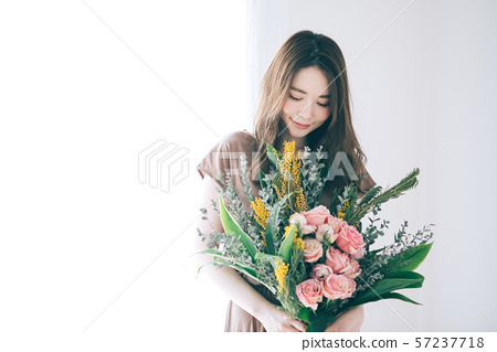 Young woman with a bouquet 57237718