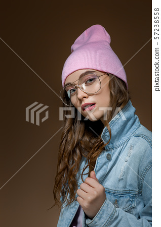 girl in jeans jacket , a pink hat and stylish glasses 57238558
