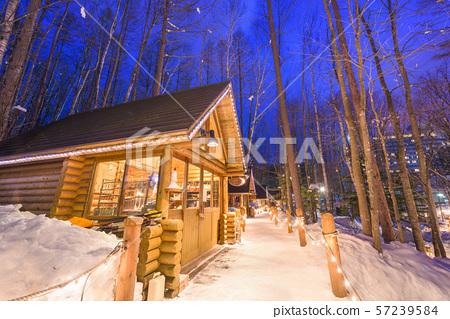 Furano, Hokkaido, Japan winter cabins at twilight. 57239584