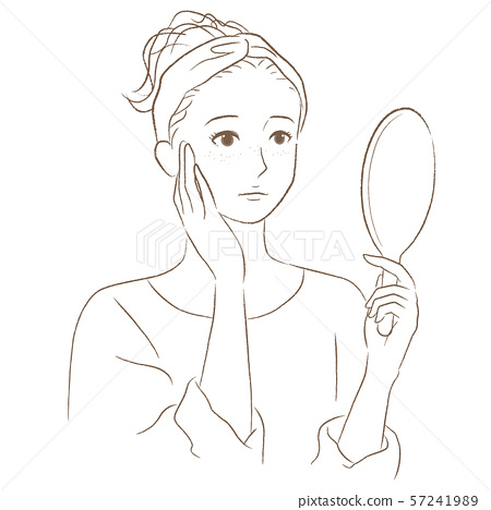 A woman watching a hand mirror 57241989