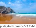 Surf on an Empty Beach and Rocky Ocean Coast 57243561