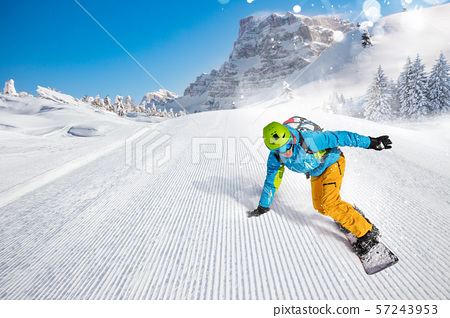 Man snowboarder riding on slope. 57243953