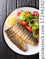 grilled mackerel fillet with a side dish of fresh 57246262