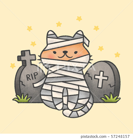 Mummy cat costume sitting in front of tombstones 57248157