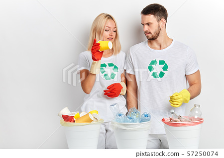 young volunteers separating glass, plastic and paper 57250074
