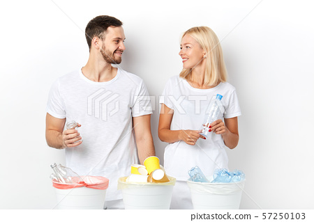 attractive loving couple helps the environment 57250103