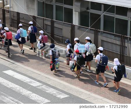 Elementary school students attending school 57252990