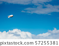 White airship with camera floating in sky 57255381