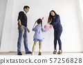 Happy funny child girl playing balloon with parent 57256828