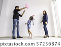 Happy funny child girl playing balloon with parent 57256874