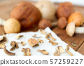 dried mushrooms on baking paper 57259227