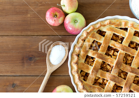 close up of apple pie on wooden table 57259521