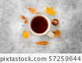 cup of tea, autumn leaves, acorns and chestnut 57259644