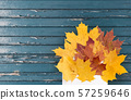 autumn maple leaves with envelope on old boards 57259646