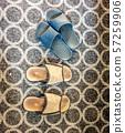 Vintage flip flops standing on vintage carpet 57259906