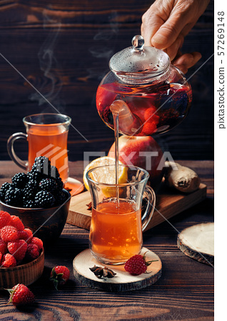 Pouring freshly brewed fruit and herbal tea 57269148