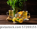 Hot tea with lemon, orange, ginger and mint 57269155