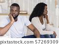 Boyfriend and girlfriend ignoring each other after argument 57269309